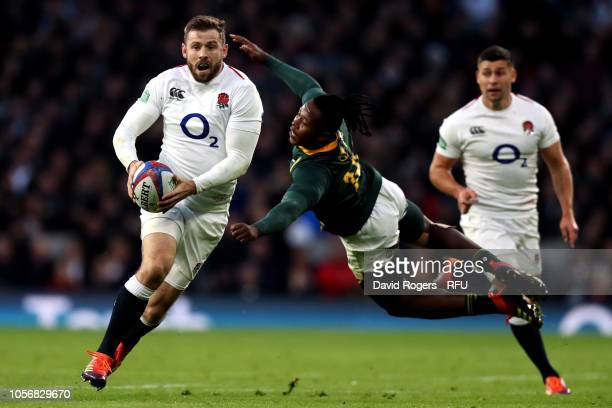 Sibusiso Nkosi of South Africa attempts to tackle Elliot Daly of England during the Quilter International match between England and South Africa at...