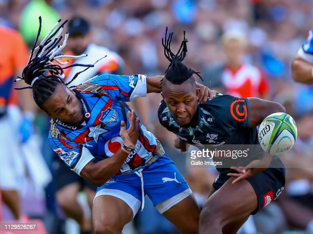 Sibusiso Nkosi of the Cell C Sharks and Rosko Specman of the Vodacom Bulls look to challenge for the loose ball during the Super Rugby match between...