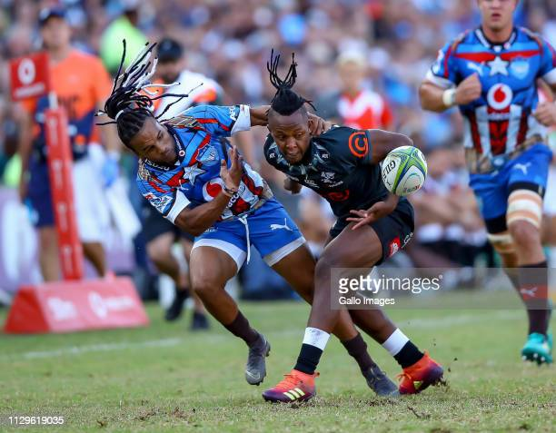 Sibusiso Nkosi of the Cell C Sharks and Rosko Specman of the Vodacom Bulls go for the loose ball during the Super Rugby match between Vodacom Blue...