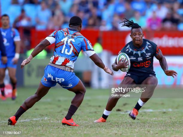 Sibusiso Nkosi of the Cell C Sharks looks to get around Warrick Gelant of the Vodacom Bulls during the Super Rugby match between Vodacom Blue Bulls...