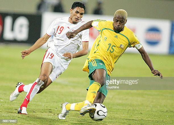 Sibusiso Zuma of South Africa and Anis Ayari of Tunisia in action during the African Cup of Nations match between South Africa and Tunisia at the...