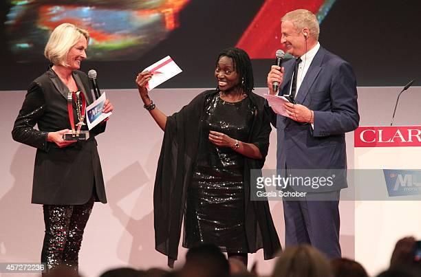 Sibylle Bassler Mona Lisa Auma Obama founder 'Sauti Kuu' and Christian Courtin Clarins CEO Clarins attend the Prix Courage Award 2014 on October 15...