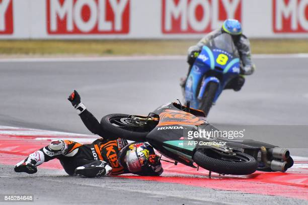 Sic Racing team's Japanese rider Ayumu Sasaki falls from his bike during the San Marino Moto3 Grand Prix race at the Marco Simoncelli Circuit in...