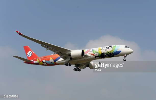 Sichuan Airlines' pandathemed Airbus A350900 arrives at the Chengdu Shuangliu International Airport after 10 hour's flight on August 9 2018 in...
