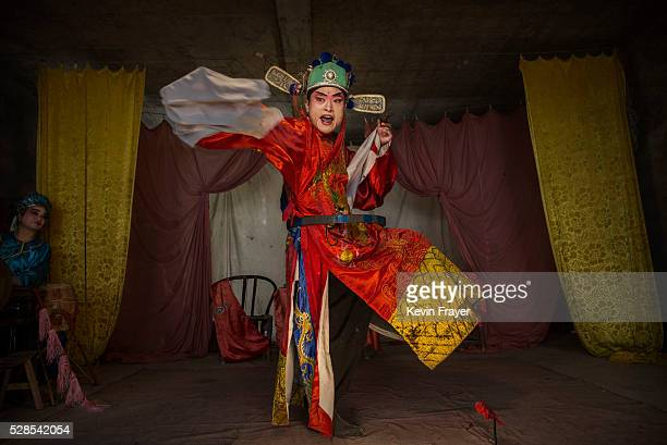 Sichuan Opera performer Wu Yonghong 26 years of the Jinyuan Opera Company performs for villagers at the Dongyue Temple on May 2 2016 in Cangshan...