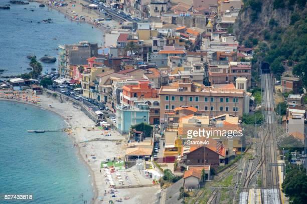 sicilian coastline near taormina - giardini naxos, italy - naxos sicily stock pictures, royalty-free photos & images