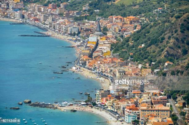 sicilian coastline near taormina - giardini naxos, italy - taormina stock photos and pictures