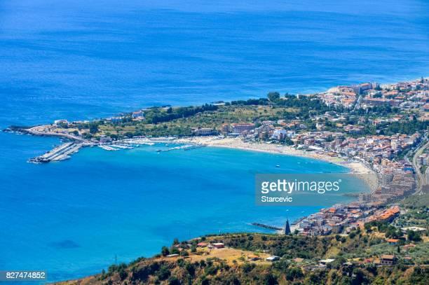 sicilian coastline near taormina - giardini naxos, italy - giardini naxos stock pictures, royalty-free photos & images