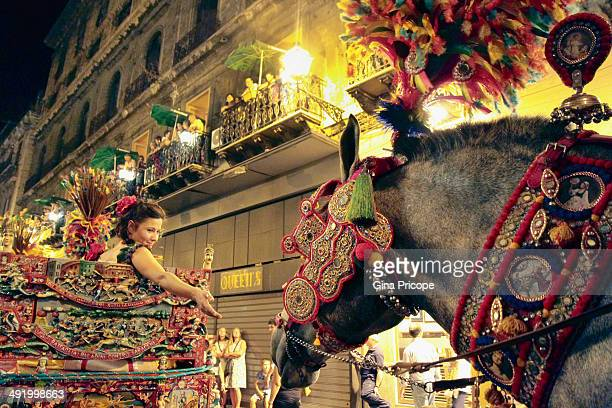 CONTENT] Sicilian girl in the chariot during the procession of St Rosalia Palermo 2010