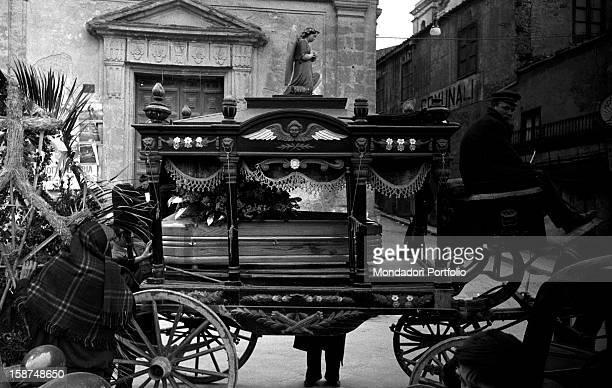 A Sicilian man driving an ancient hearse Sicily March 1958