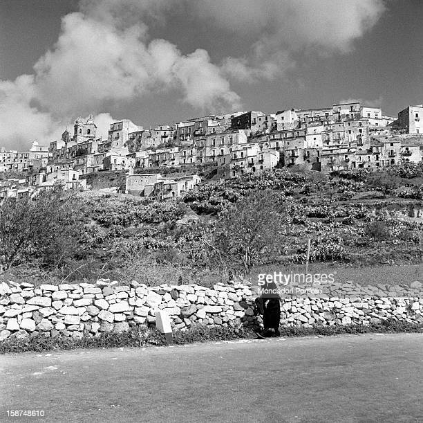 A Sicilian woman standing at the foot of the hill of the neighbourhood called Ragusa Ibla Ragusa 1955