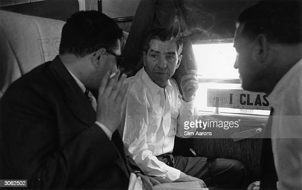 Sicilianborn American gangster Charles 'Lucky' Luciano on board the Messina Termini train in Sicily His criminal empire includes narcoticspeddling...