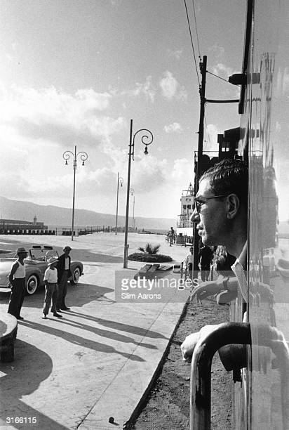 Sicilianborn gangster Charles 'Lucky' Luciano leaning out of a window in his native Sicily Whilst in prison between 1936 and 1946 he founded the...