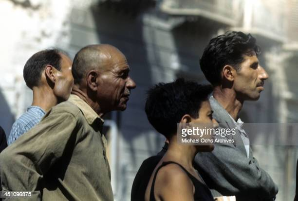 Sicilians look on as the Allied forces drive though town after the invasion of Sicily 5 days after winning the campaign called Operation Husky during...