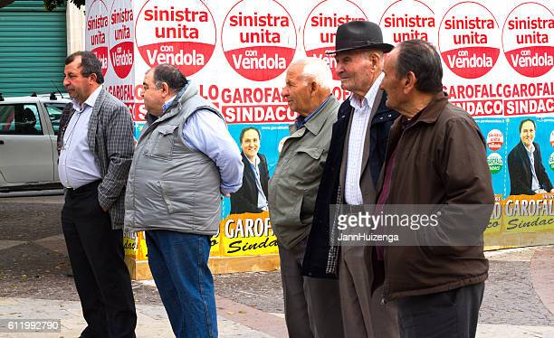 Sicily: Five Senior Men Stand Near Political Posters
