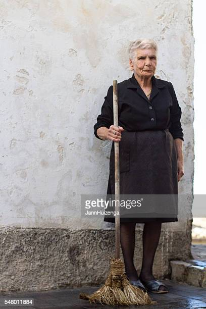 Sicily, Italy: Portrait of Senior Woman with Palm Leaf Broom