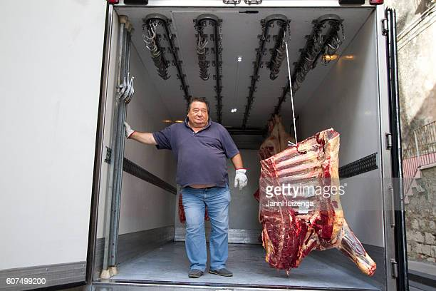 Sicily Man With Cow Carcass In Delivery Truck