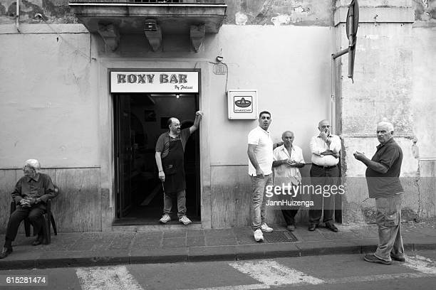 Sicily Scene: Group (Barista and Customers) Outside Bar