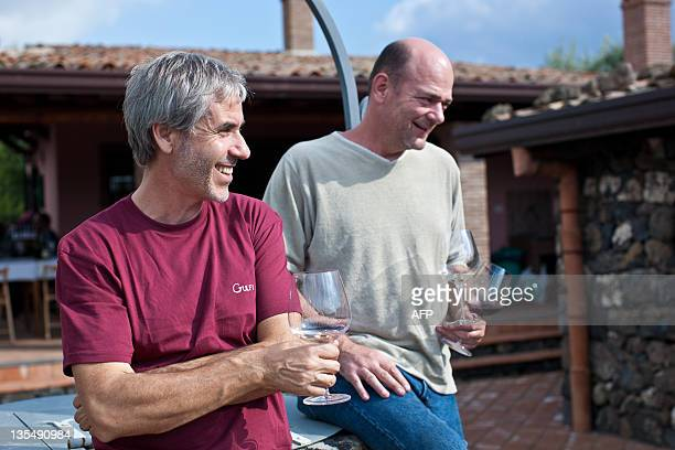 Sicily's top wine consultant Salvo Foti stands on December 2 2011 with a guest outside the association of local wine experts I Vigneri north of Mount...