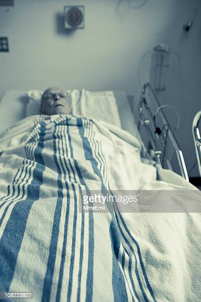 sick and senior man sleeping in hospital bed - gerontology stock pictures, royalty-free photos & images