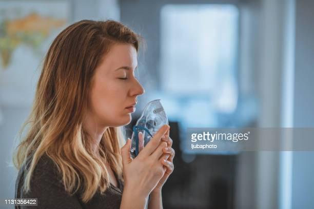 sick beautiful young woman - amigdalite imagens e fotografias de stock
