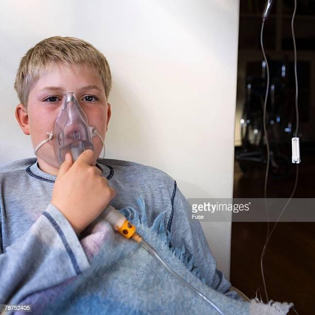Sick Boy Wearing Oxygen Mask