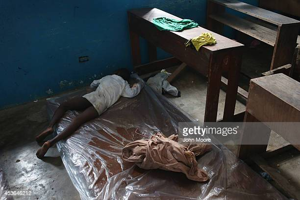 A sick child lies in a classroom now used as Ebola isolation ward on August 15 2014 in Monrovia Liberia People suspected of contracting the Ebola...