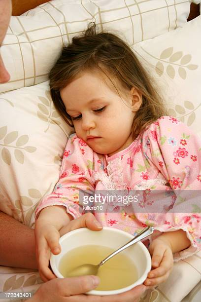 sick child - chicken soup stock photos and pictures