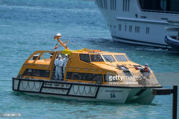 Sick crew members of the two boats arrive in lifeboats at the US Coast Guard Base in Miami on March 26 2020 The US Coast Guard is facilitating...