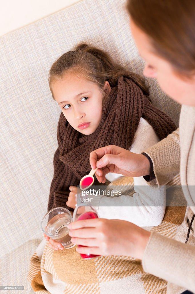 Sick daughter : Stock Photo