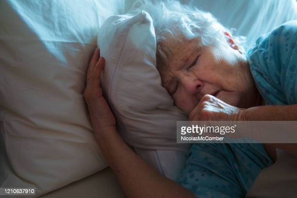sick elderly woman in bed coughing - cough stock pictures, royalty-free photos & images