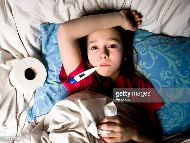 Sick Little Girl in Bed with Thermometer