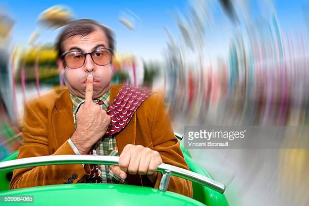 A sick man in a fairground carousel