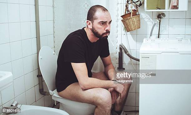 Sick man in the toilet