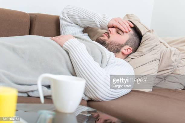 sick man with flu - coughing stock photos and pictures