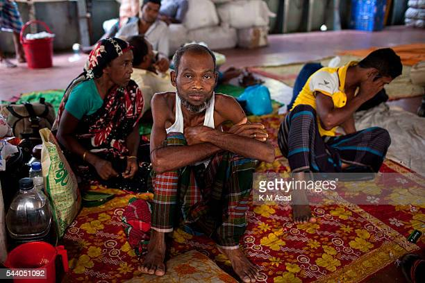 SADARGHAT DHAKA BANGLADESH Sick men sit in a boat deck as they travel to their village Bangladesh is one of the most densely populated countries in...