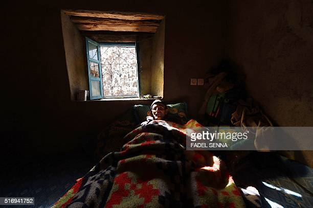 A sick Moroccan man lies in bed in Taghzirt an isolated village in the elHaouz province in the High Atlas Mountains south of Marrakesh on March 4...