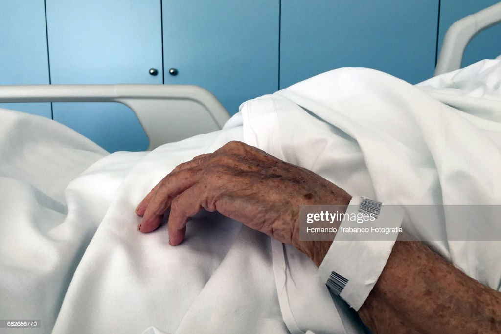 Sick old woman in a bed : Stock Photo
