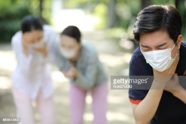 Sick people with sore throat. Catching cold, having cough.