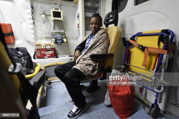 A sick returnee sits in an ambulance from a chartered aircraft that brought home 150 migrants from Libya at the Murtala Mohammed International...