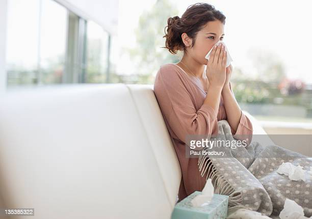 sick woman blowing her nose - handkerchief stock pictures, royalty-free photos & images