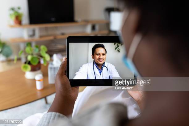 sick woman having online consultation with doctor - healthcare stock pictures, royalty-free photos & images