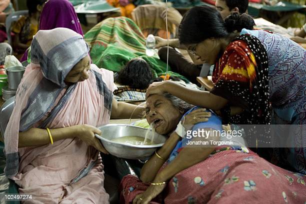 A sick woman is cared for in a the crowded ICDDRB Cholera Hospital in Dhaka Bangladesh on April 25 2006 At times nearly 1000 patients with diarrhea...