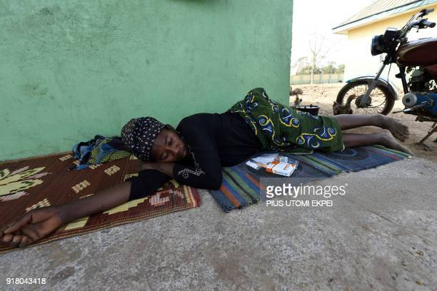 A sick woman lies beside her medication at the internally displaced people camp occupied largely by women and children affected by herders and...