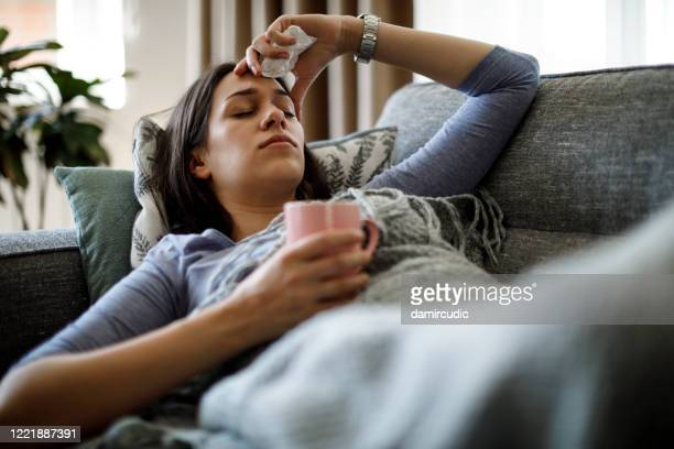 sick woman lying in bed - symptom stock pictures, royalty-free photos & images