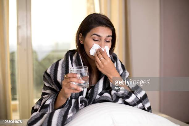 sick woman suffering from headache bed