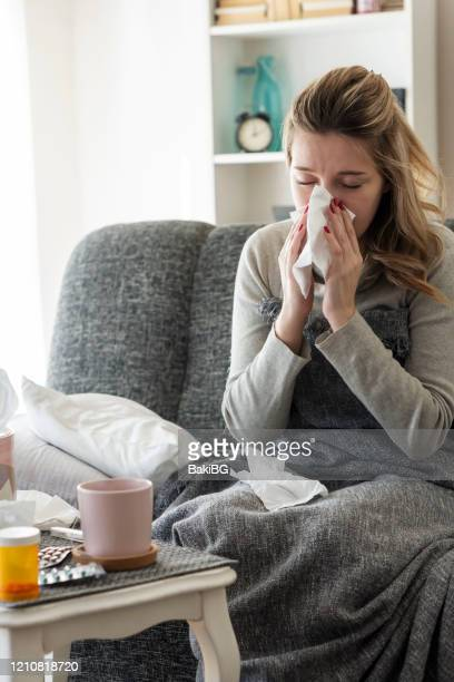 sick woman with flu at home - cold and flu stock pictures, royalty-free photos & images