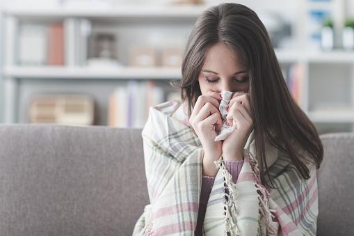 Sick woman with flu 586946066