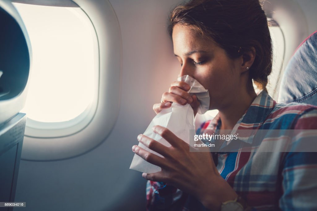 Sick woman with nausea in the airplane : Stock Photo
