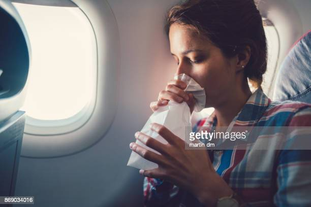 sick woman with nausea in the airplane - terrified stock pictures, royalty-free photos & images